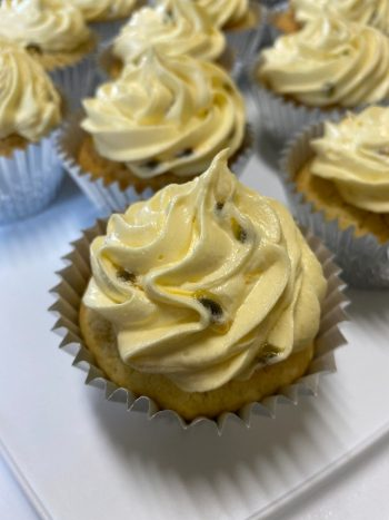 coconut cupcakes with passionfruit icing